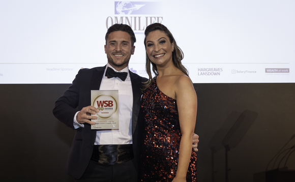 Omnilife's Barry Waring collects the award from Jess Robinson