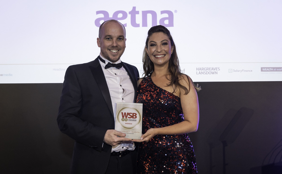 Aetna International's Andy O'Cain collects the award from host Jess Robinson