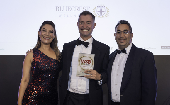 Peter Blencowe (centre) receives the award from Jess Robinson and Salary Finance co-founder Daniel Shakhani